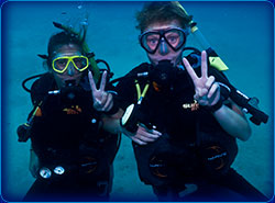 Discover Scuba Diving Students – enjoying their dives and posing for the Underwater Photographer.